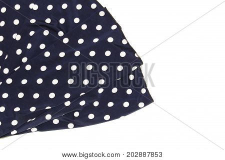 Draped blue silk with polka dots as a background.