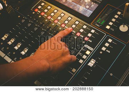 Close Up Of Technicial Hand With Music Mixer Equalizer Console For Mixer Control Sound Device. Audio