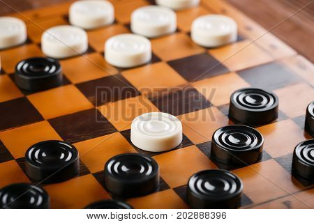 Checkerboard With Checkers. Game Concept. Board Game. Hobby. Checkers On The Playing Field For A Gam