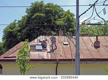Kosice Slovakia - June 28 2017: workers are repairing the roof of building in Kosice Slovakia