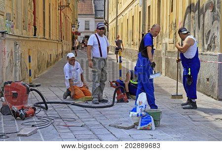 Workers Are Paving Tiles On The Street In Kosice, Slovakia