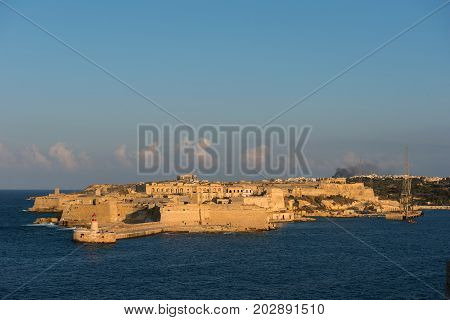 Ancient City Of Valetta Fortress In Late Afternoon Lights. Malta