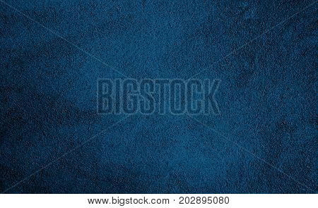 Beautiful Abstract Grunge Decorative Navy Blue Dark Wall Background. Art Rough Stylized Texture Banner With Space For Text. Textured background with bright center spotlight