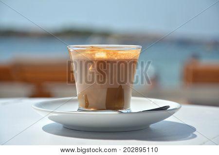 Espresso macchiato in the beach cafe in Spain