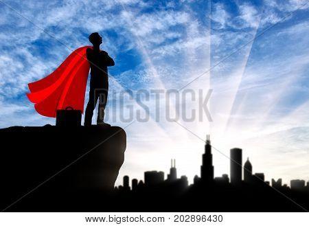 Successful Superhero Businessman Looks At The City