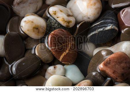 Sea Pebble, Sea Stones Background, Beach Rocks. Background From Sea Stones For Design. Abstract Back