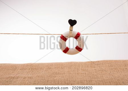 Life Preserver Attached To A String With Heart