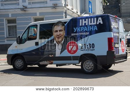 Kiev Ukraine - June 21 2017: Car of the TV channel ZIK with the outdoor advertising of the TV show of the authorship of the disgraced politician Mikhail Saakashvili. The inscription on the car