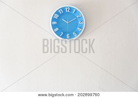 Morning night or bed time with 10:10 clock on white concrete wall interior background with copy space message board concept. 10 am is the late time in the morning. 10 pm is the bed time in the night