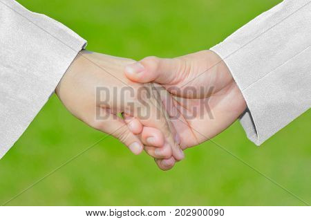 Love Care Symbol Hand Holding Hand With White Suit&Dress Couple Valentine Wedding Married Romantic Concept Background. Wedding is the important moment in human life