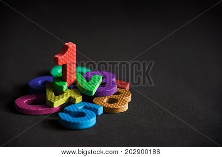 Business winner or leader number one stand on the pile of number foam blocks success achievement concept background. Number one metaphor to winner leader concept