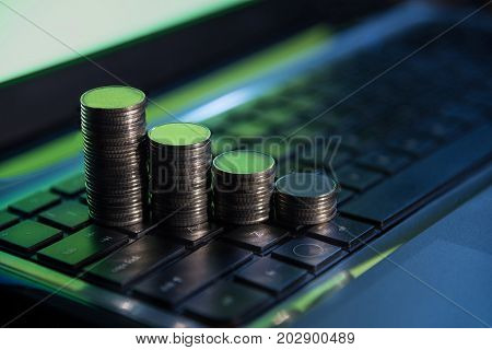 Financial business money coins on keyboard online stock trade investment banking concept background