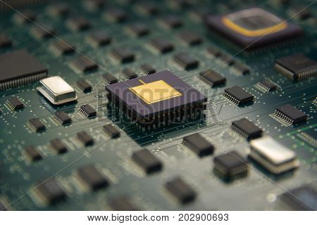 Electronic board with cpu processor and electronic chips technology concept background with DOF Effect
