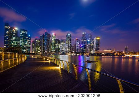 Singapore - February 14 2017: Singapore Cityscape Financial building with Dramatic Cloud in Marina Bay area Singapore at  Dusk