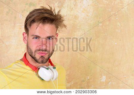 American Handsome Bearded Guy With Headphones.
