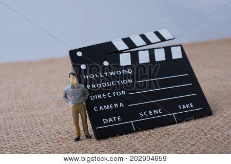 Movie  Clapper And A Man Figurine