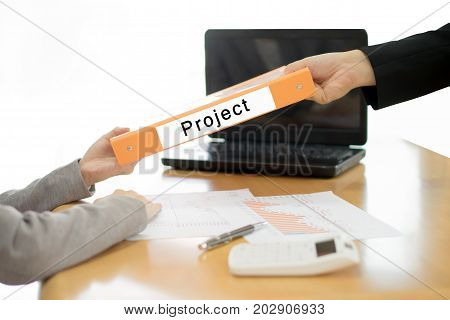 Businesswoman sends the debtor document to the businessman. selective focus.