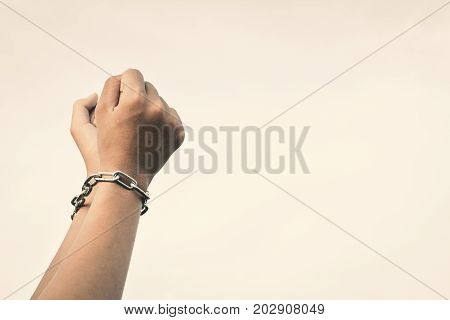 Close up hands in chains concept lack of freedom