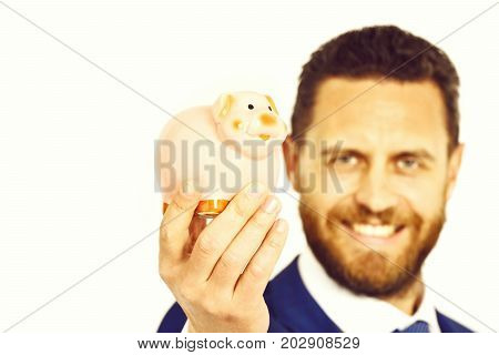 savings and effective investment future needs deposit happy businessman in suit and tie holding piggybank budgeting expenses