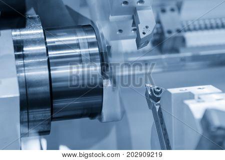 CNC lathe machine (Turning machine) while cutting the aluminium part.Hi-precision CNC machining concept.