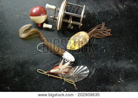 Vintage collection of lures, fishing bobber and fishing reel