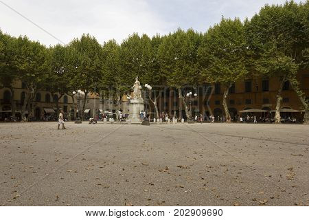 LUCCA, ITALY - AUGUST 15 2015: Napoleone square in Lucca city in Tuscany Italy with few people around