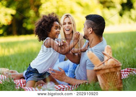 Happy family having fun time together on picnic