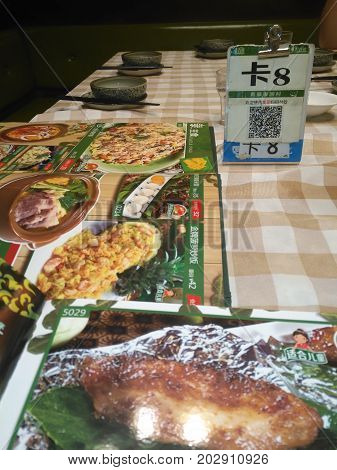 ZhongshanChina-August 20 2017:Chinese restaurant with payment via QR code.QR code for payment and money transfering becomes very common and popular in China.