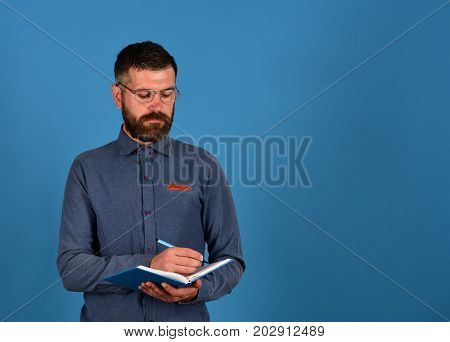 Professor With Concentrated Face. Man With Beard And Book