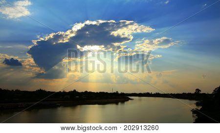 Sun Beams Through Clouds At Sunset