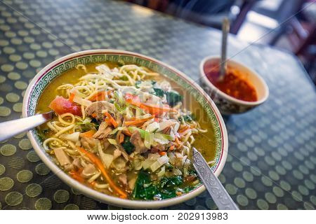 Traditional tibetian food is momo soup with vegetables  Darjeeling, India.
