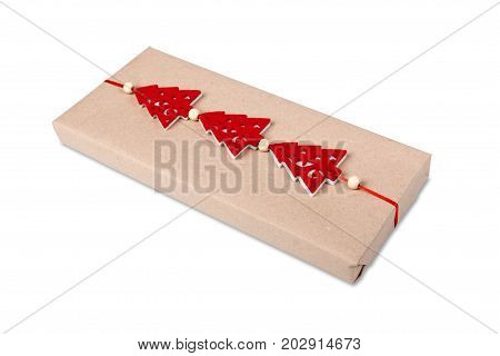 Gift box or mail parcels group, post delivery wrapped with kraft paper and twine, decorated with red toy christmas trees isolated on white background. Craft present for winter holidays