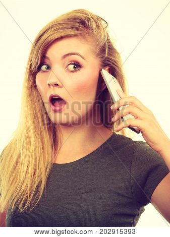 Unpleasant conversation bad relationships concept. Angry young blonde woman talking on phone