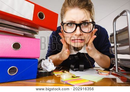 Depressed Businesswoman Sitting At Desk