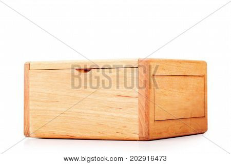 A jewelry box made of wood, a container for keeping precious things, bracelets, rings, earrings, necklaces, cuff links, golden and silver chains isolated on a white background.
