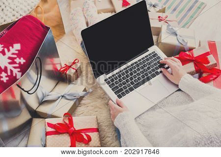 Christmas online shopping, top view. Female buy presents, prepare to xmas on laptop, copy space on screen. Winter holidays sales