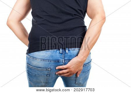 Young man having viral diarrhea holding his bottom on isolated back view