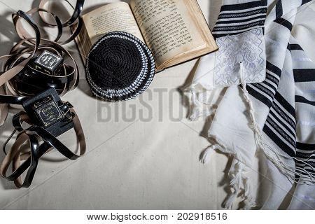 JERUSALEM, ISRAEL - DECEMBER 21: Jewish ritual objects, prayer vestments, Talit, Kippah, Tefillin and Siddur - jewish prayer book in Jerusalem, Israel on December 21, 2016