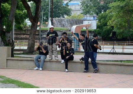 Georgetown/Malaysia - September 2012: Photographers in branded Nikon T-shirts on the waterfront of Georgetown Penang Island Malaysia