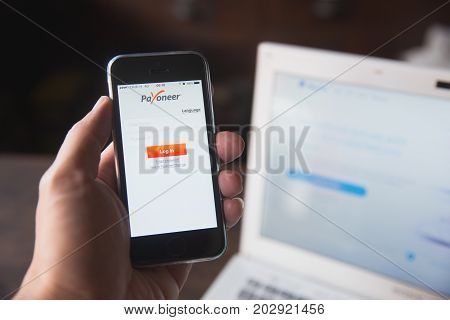 Bangkok Thailand - August 31,2017 Payoneer On Iphone With Computer Laptop Background. Payoneer Mass