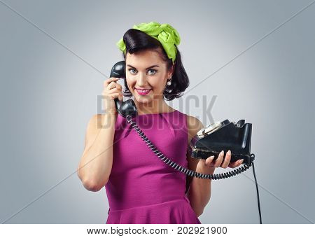 Beautiful Woman In Pin Up Style With Vintage Phone.