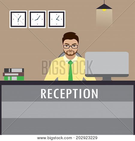 Man Receptionist Sitting  At Reception Desk.