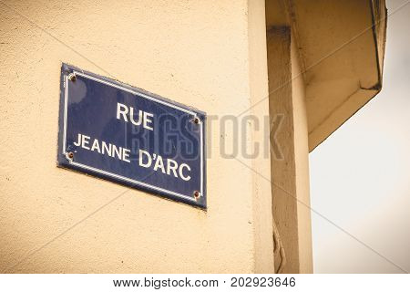 old French street sign where it is written rue Jeanne d'Arc