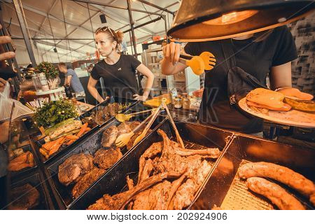 KYIV, UKRAINE - JUL 23, 2017: Meat and other meals ready for customers of fast-food cafe at popular Street Food Festival on July 23, 2017. Kiev is the 8th most populous city in Europe