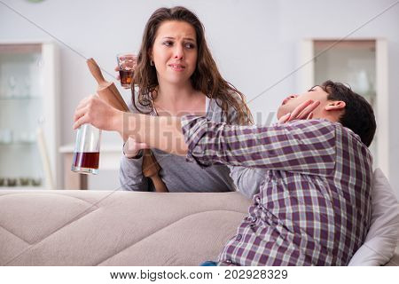 Domestic violence concept in a family argument with drunk alcoho