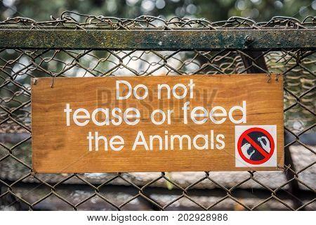 Zoo warning sign at zoo of Darjeeling, India.