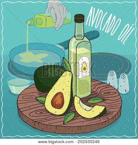 Glass bottle of Avocado oil and fruits of Persea americana plant. Hand pouring oil on frying pan. Natural vegetable oil used for frying food