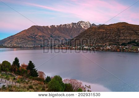 Sunset Over Lake Wakatipu And The Remarkables Mountain Range In Queenstown, New Zealand.