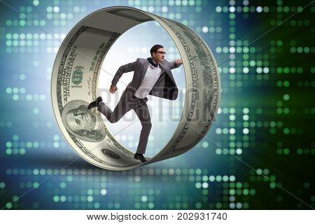 Businessman in hamster wheel chasing dollars