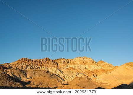 Beautiful golden light in the hills around Artists Drive in Death Valley National Park in California